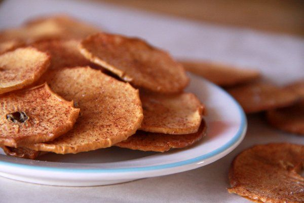 Baked apple chips with cinnamon sugar -- a low sugar, high fiber, full flavor snack for kids. Bonus: your house will smell amazing while they bake! From Foodlets.com