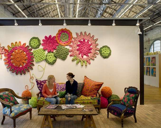 Crochet wall art is part of the super creative and cool looking headquarters of Urban Outfitters