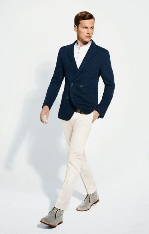 Go for a classic style in a deep blue double breasted blazer and white dress pants. Feeling brave? Complete your look with grey suede chukka boots.  Shop this look for $150:  http://lookastic.com/men/looks/white-henley-shirt-navy-double-breasted-blazer-white-dress-pants-grey-desert-boots/6495  — White Henley Shirt  — Navy Double Breasted Blazer  — White Dress Pants  — Grey Suede Desert Boots