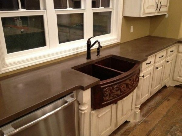 making kitchen countertops concrete with metal farmhouse sink below moen black bar faucet against clear glass inserts for single hung window parts