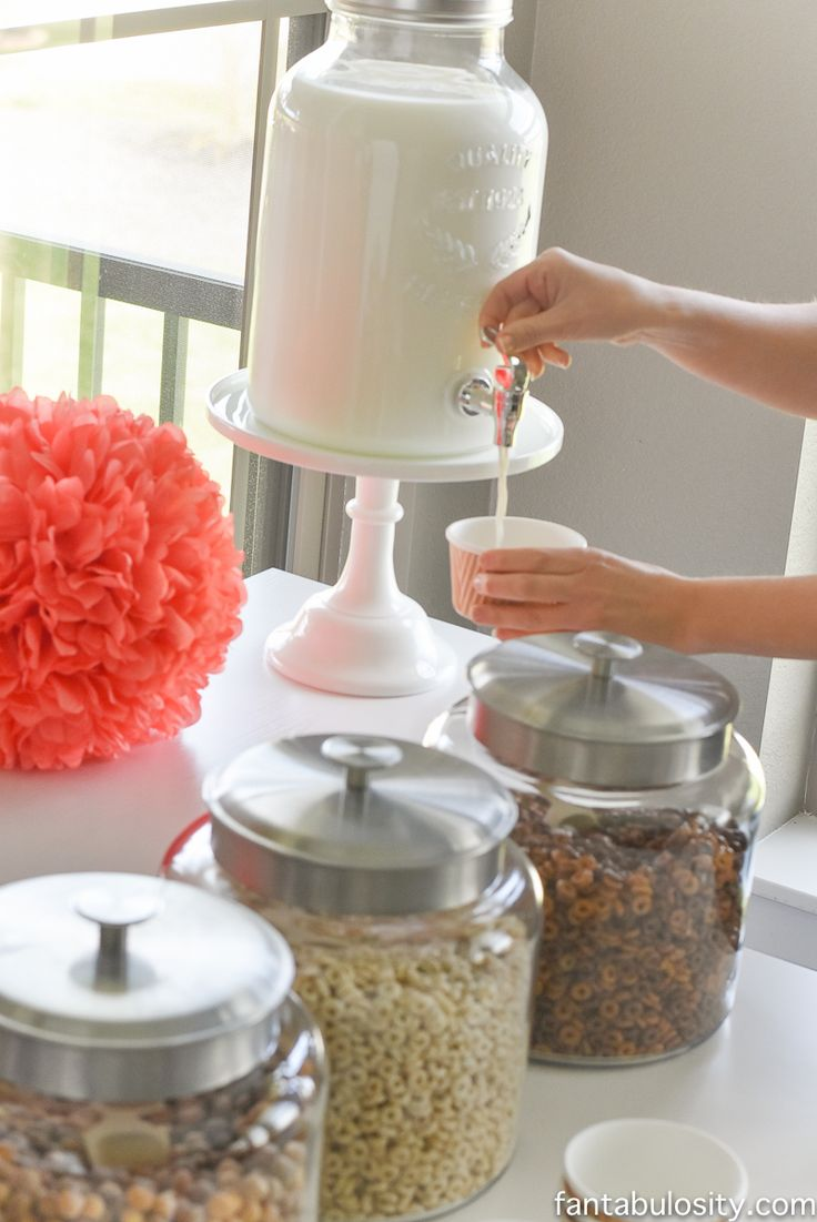 Milk in a drink dispenser for a cereal bar!  I love this! Cereal Bar Ideas: Brunch shower, bridal shower, mother's day, baby shower breakfast party