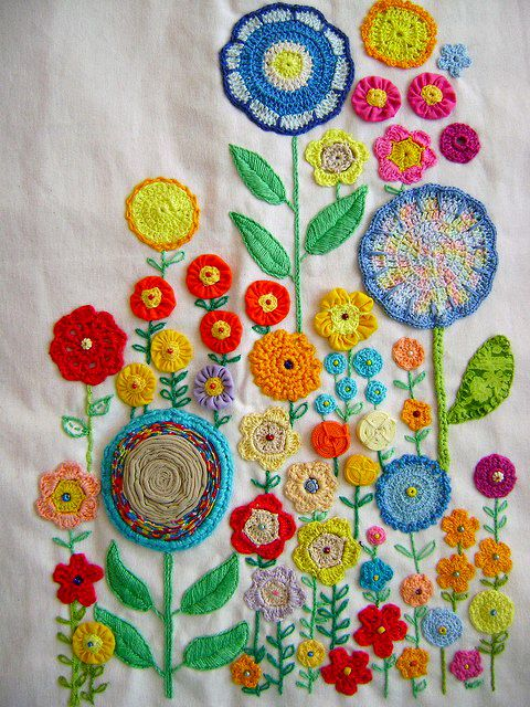 Pretty embroidery with colorful flowers that have an abstracted, kind of mod 1960s feel about them.