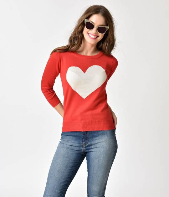 Heart on your sleeve? Try front and fabulously center! A sweet knit sweater top in a tomato red coloring, this retro inspired piece is cozy and soft. With a classic crew neck, long sleeves and stay-in-place hem, adorned with a knit-in oatmeal heart over t