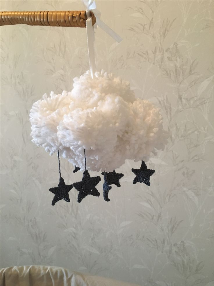 Crib mobile with yarn balls and crocheted stars