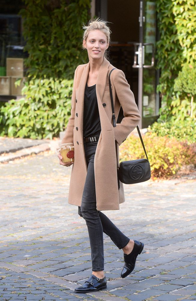 Anja Rubik // camel coat, black tee, skinny jeans & monk strap shoes