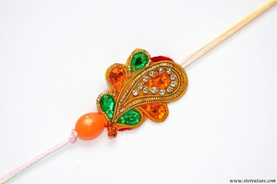 f096b1c4917bd1849f5a3e12d2a9539f rakhi handicraft - Rakhi Handmade Orange & Green Paisley Sibling Band Zircon pearls work Rakshaband...