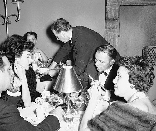 """Frankie Sinatra and actress Ava Gardner, back together again, toasted in the New Year at the fashionable restaurant """"Hosteria dell'Orao"""" in Rome, Dec. 31, 1953."""