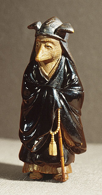 Kokoku (Japan) Fox Disguised as Priest, mid-19th century Netsuke, Wood with lacquer, inlays, 2 1/8 x 7/8 x 7/8 in. (5.4 x 2.2 x 2.2 cm) Raymond and Frances Bushell Collection (AC1998.249.122) Japanese Art Department.