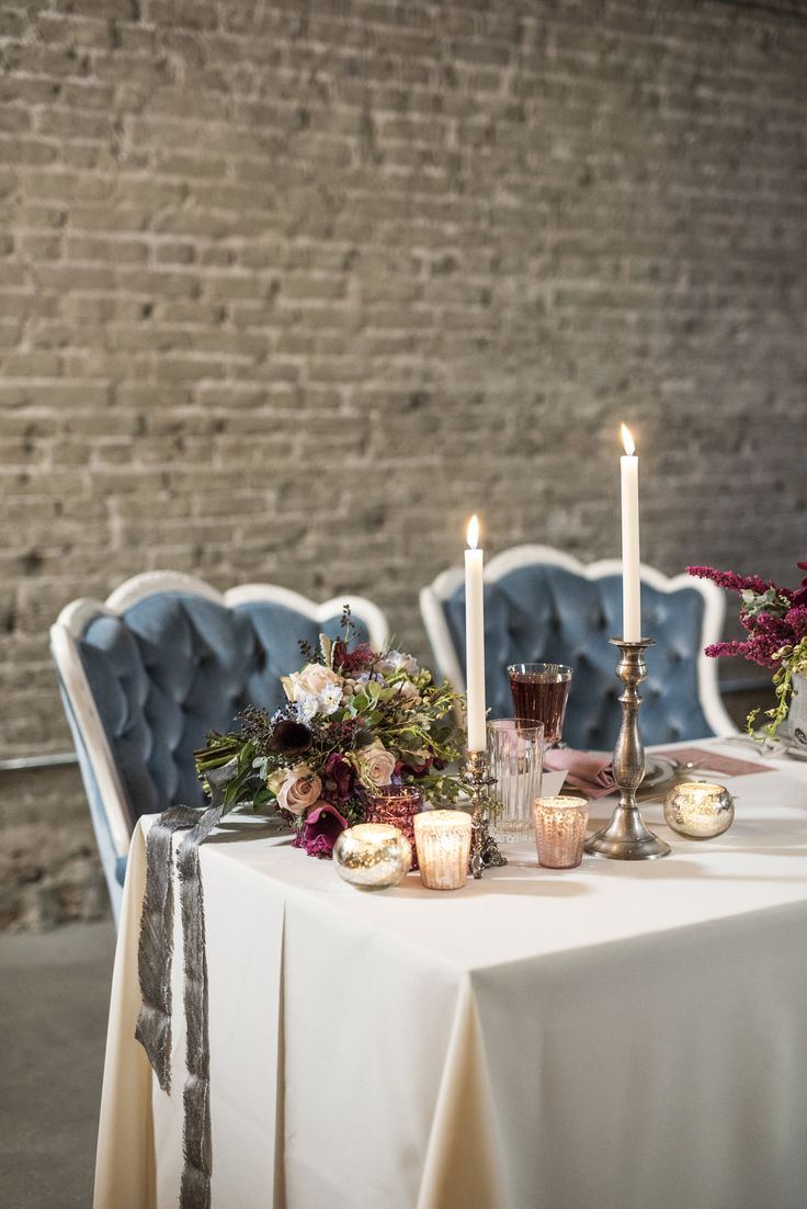 Vintage French Romance, vintage china, velvet blue chairs, brick room, deep colored wedding, deep maroon wedding, candle lit wedding, candle lit, old fashion bride, red lips, lace wedding dress, french romantic.