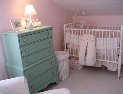 Pink, teal green and antique white vintage inspired nursery room for a baby girl: The pink and green color scheme for Sarah's vintage inspired nursery theme is the fabric bought from House Inc. Fabrics. that was used to sew the baby's