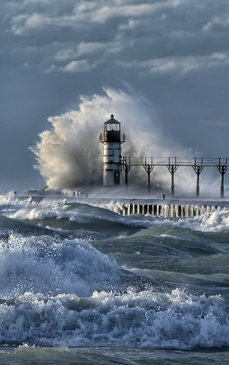 The powerful crash and churn of Lake Michigan waves against the lighthouse at St. Joseph, Michigan.