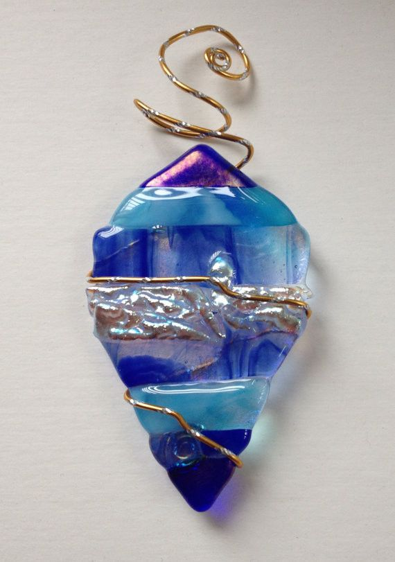 A beautiful little ornament traditional in shape, but modern is style. Featuring gorgeous shades of blue and turquoise with silver ice dichroic glass. This is a one of a kind ornament that will look b