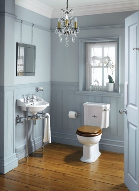 vintage bathroom...very cute but needs less blue...maybe white on upper or lower walls.  Adorable sink and chandelier.