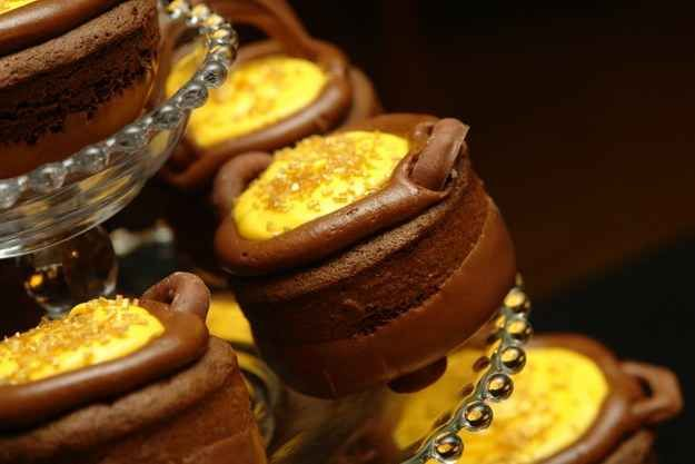 "Instead of cupcakes, serve everyone Cauldron cakes with gold frosting. | 29 Essentials For Throwing The Perfect ""Harry Potter"" Party"