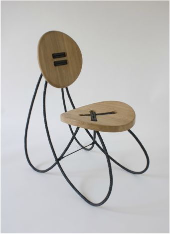 Button chair (Knappe knopen) by Tjimkje de Boer. This innovative chair is inspired by the wooden button we know from the clothing industry. The two buttons -made of solid oak- are strung together by magnified carbon yarn to form the seat and backrest of the chair. The yarn is traditionally manufactured by hand and impregnated with epoxy, which dictates the exceptional construction of the chair. http://www.tjimkje.com/button-chair.html | http://www.knapontwerp.com