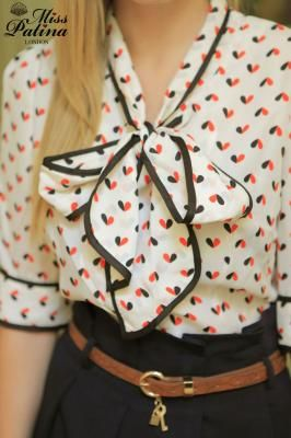 Love the black trim on the bow and collar. Cute blouse and belt                                                                                                                                                      More