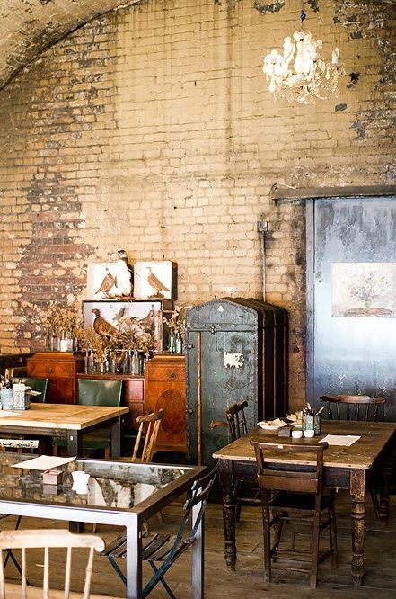 love the mismatched tables and old brick wall... hurwundeki cafe   london, uk