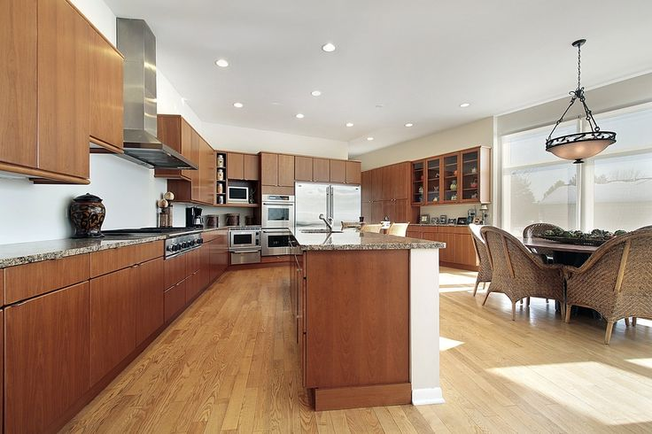 This spacious dark wood kitchen features beautiful wood cabinets with plenty of cupboard space.