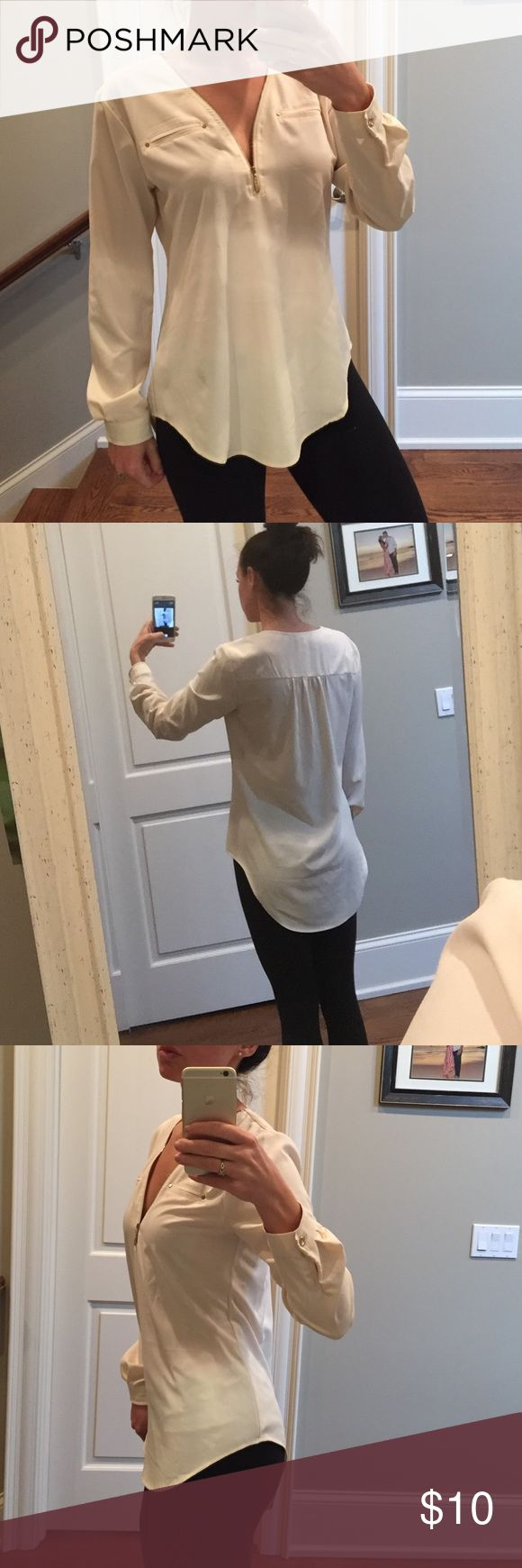 Cream long sleeve blouse Hot Miami styles! Long sleeve, zip up front blouse! Great for a In style business casual shirt! Longer in the back so great with leggings. Worn once! Tops Blouses