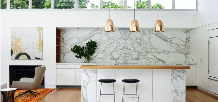 Kitchen Design Idea - How To Add Marble In Your Kitchen // A partially marble island, marble countertops and backsplash along the back wall of this kitchen makes for a clean and modern design.