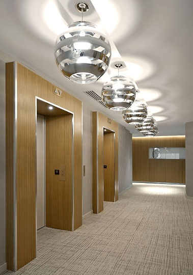 Elevator lobby with 3D horseshoe framing feature in ...