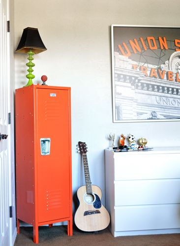 Love the way one of our orange kids lockers looks in this boy's room!