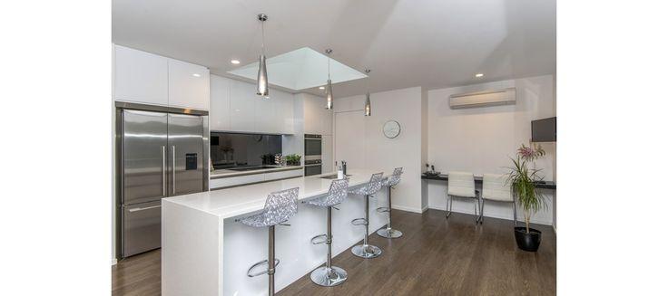 Modern white kitchen, pendant lights