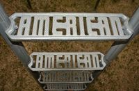 """A metal slide in Victor, Colorado, had step treads with the name """"American"""" in them. Photographed in 2008. (Photo by Brenda Biondo)"""