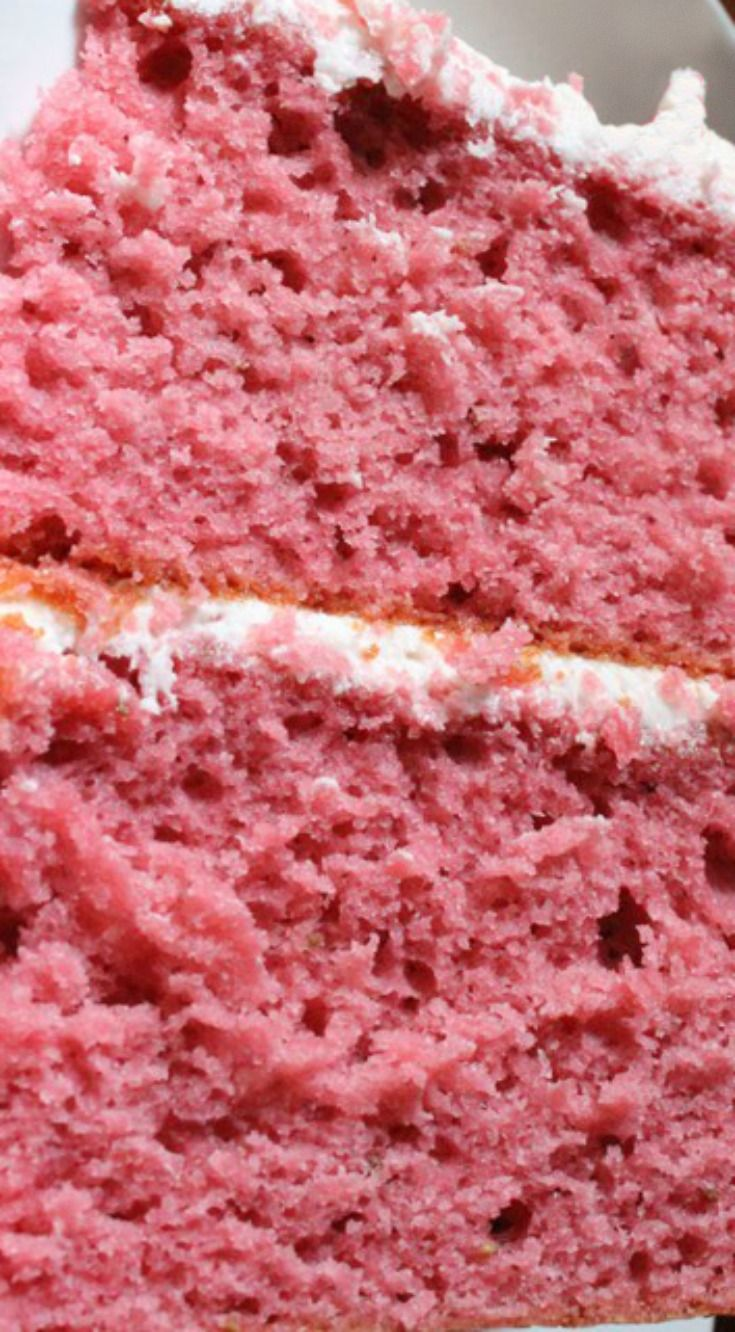 Fresh Strawberry Cake with Strawberry Buttercream ~ A strawberry lovers dream come true... This cake is made with fresh strawberries in the mix, as well as in the buttercream - You can't get any more strawberry flavor in a from scratch cake!