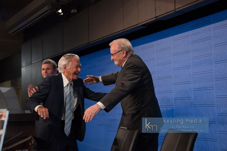 Photo of Gareth Evans and Bob Hawke embrace at the National Press Club