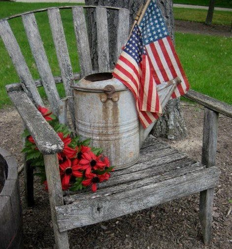 Rustic Chair...and old watering can with flags.