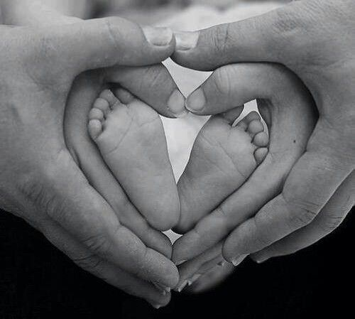 Really like this shot with newborn and family. when we get pics taken with new baby we should do this..