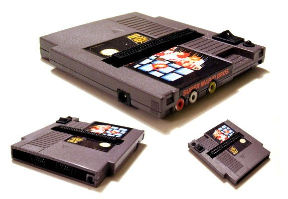 isquirtmilkfrommyeye:    Somehow some way people have managed to cram a fully functional NES system into a NES game cartridge. The 72 pin connector is exposed on the face of the game cartridge and there are two controller ports tucked away in the bottom. pokemon pokemon diy diy pokemon toys pokemon stuff