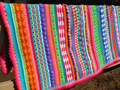 Inspiration :: Another mixed-stitch striped blanket, by Robin Sanchez of Once Upon A Pink Moon (*No specific pattern.) I'm going to have to make one of these, they look like so much crochet fun :-)