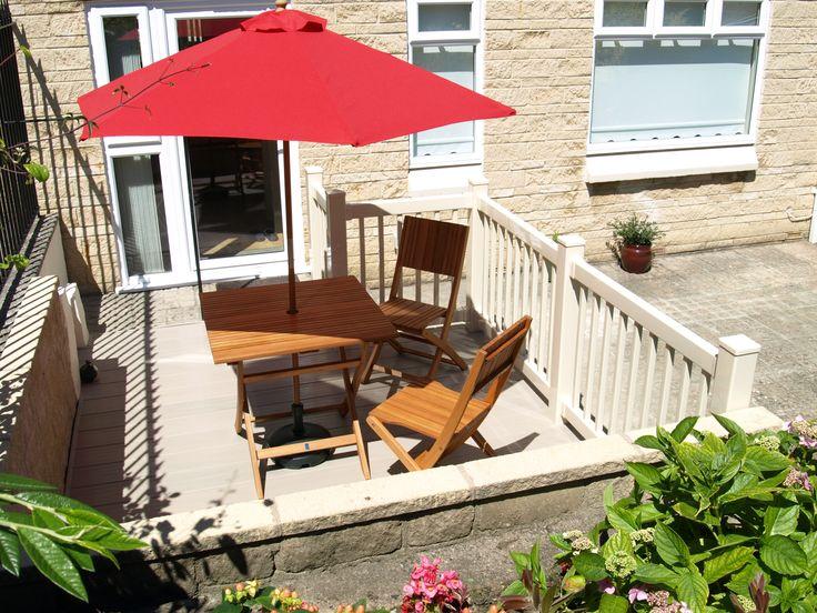 Fensys all plastic low maintenance garden decking with cream UPVC balustrade hand railing
