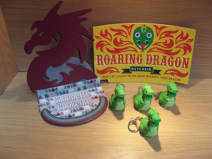 Roaring Dragon - keychain with light; bookends. Available at Best of Friends Gift Shop in the lobby of Winnipeg's Millennium Library. 204-947-0110 www.friendswpl.ca info@friendswpl.ca