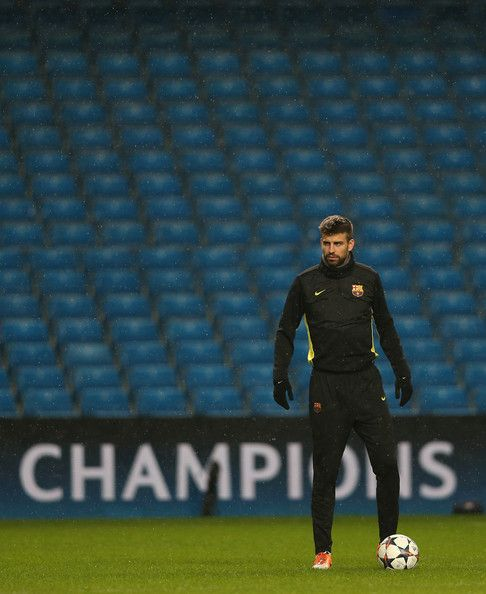 Gerard Pique of Barcelona during a training session ahead of their UEFA Champions League Round of 16 match 1st leg against Manchester City at Etihad Stadium on February 17, 2014 in Manchester, England.