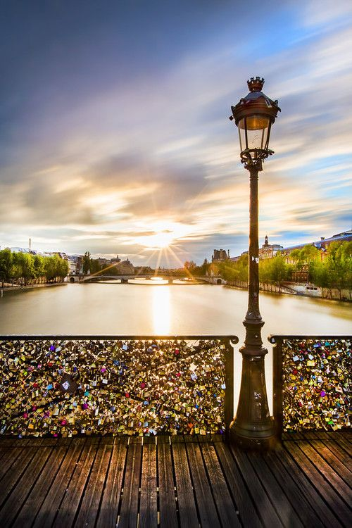 "The most perfect place in the world: Pont des Arts/ the Love Lock Bridge in Paris!   ""Couples writes their names & special date on a padlock and locks it onto the bridge. They make a wish and then throw the key into the Seine River as a symbol of their undying and everlasting love"""