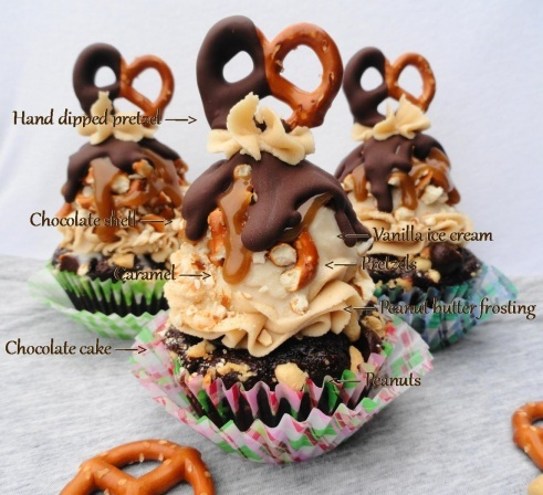 take 6 cupcake (layers from bottom up): chocolate cake, peanuts, peanut butter frosting, vanilla ice cream, pretzels, caramel, chocolate shell, topped w/ hand dipped pretzel