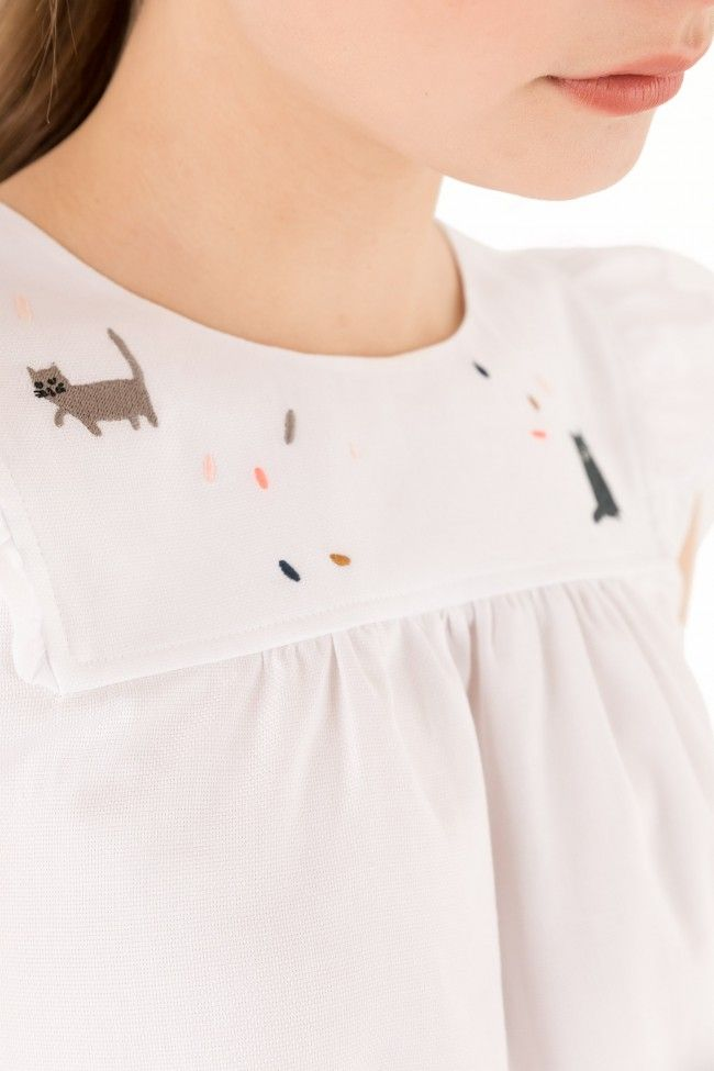 cat and confetti embroidery details on top