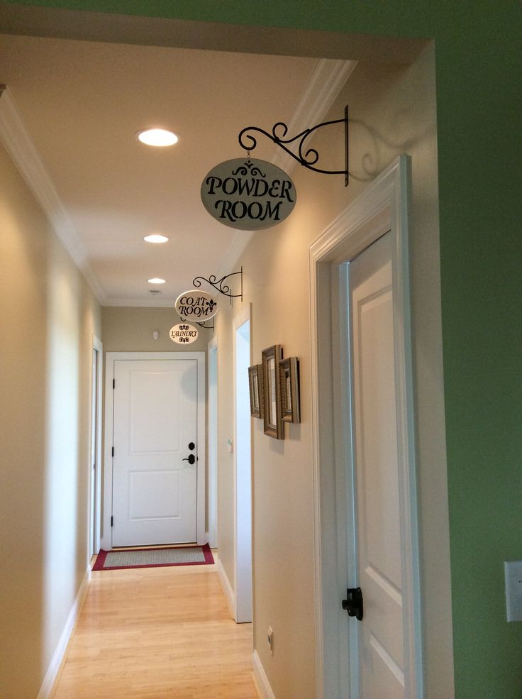 Hallway signs for powder room, mud room, and laundry.  Unfinished plaques from Wal-Mart, paint them white or cream, stencils from Wal-Mart, stencil the letters with a pencil, fill in with black paint pen, glaze the whole thing and put an eye hook in, then hang from plant hangers from Lowes.