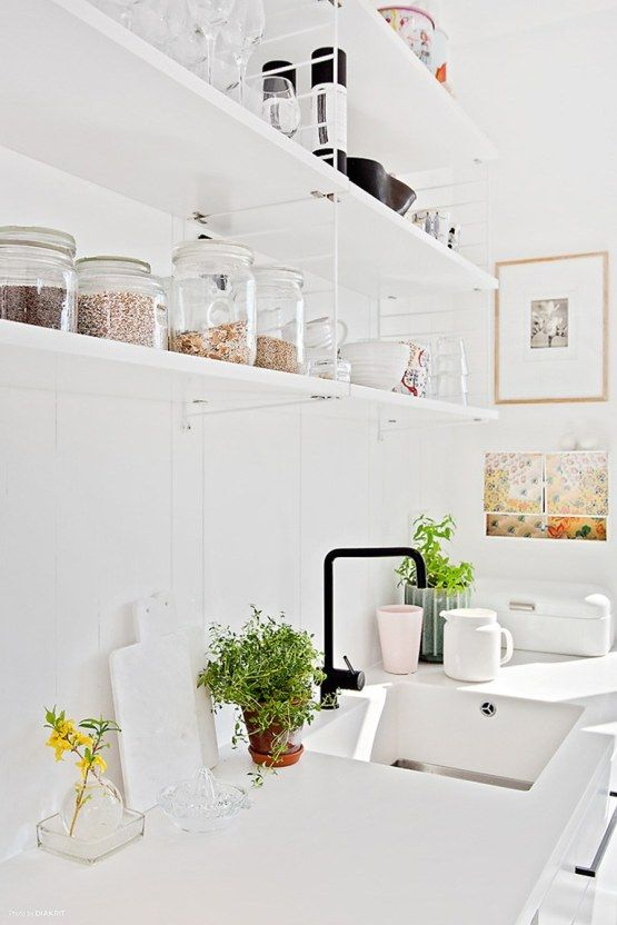 white Scandinavian kitchen. String shelf