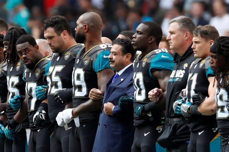 Jaguars' Shahid Khan joins players during anthem protest in first game since Trump's NFL remarks - The Washington Post