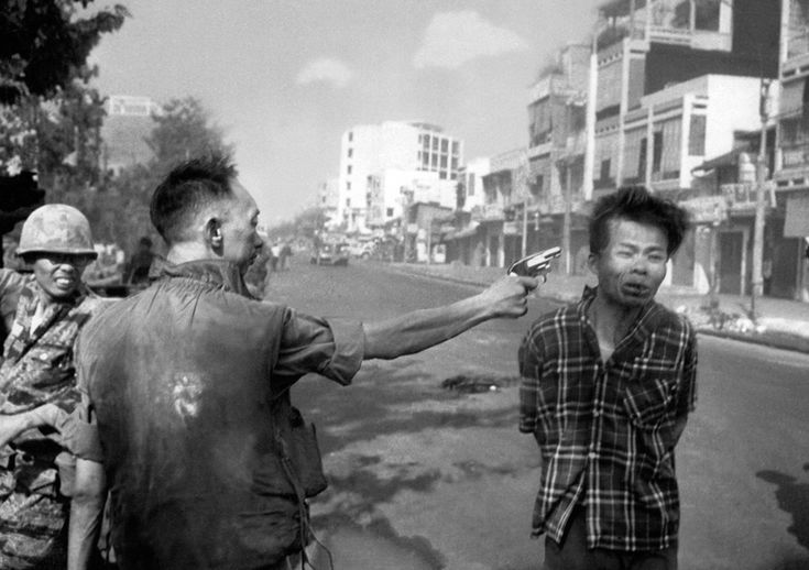 (2 of 3) South Vietnamese General Nguyen Ngoc Loan, chief of the national police, fires his pistol into the head of suspected Viet Cong officer Nguyen Van Lem on a Saigon street, on Feb. 1, 1968. (AP Photo/Eddie Adams) ~ Vietnam War