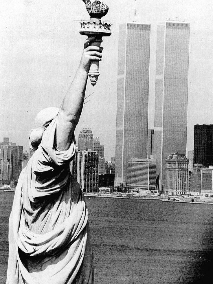 The Statue of Liberty stands in New York Harbor near the World Trade Center on July 20, 1983.