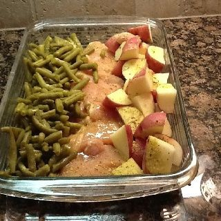 4-6 raw chicken breasts, new potatoes, green beans. Arrange in 9x13 dish. Sprinkle with a packet of Italian dressing mix and then top with a melted stick of butter. Cover with foil and bake at 350 degrees for 1 hour.