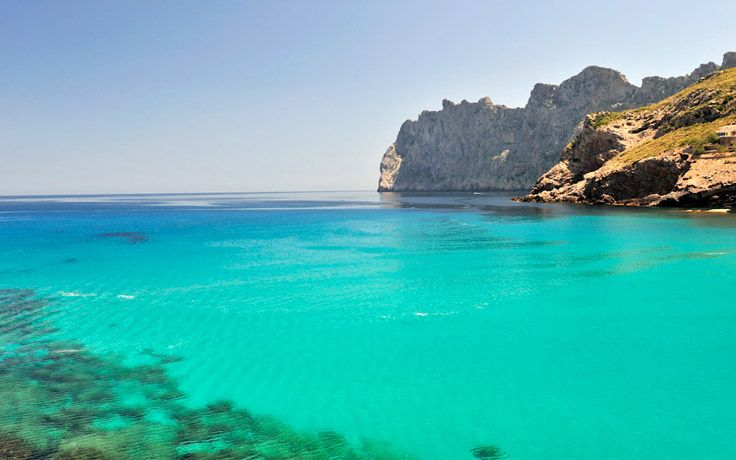 Cala San Vincente on the unspoilt north coast of Mallorca, with shallow waters perfect for families #Mallorca #familyholidays #Spain