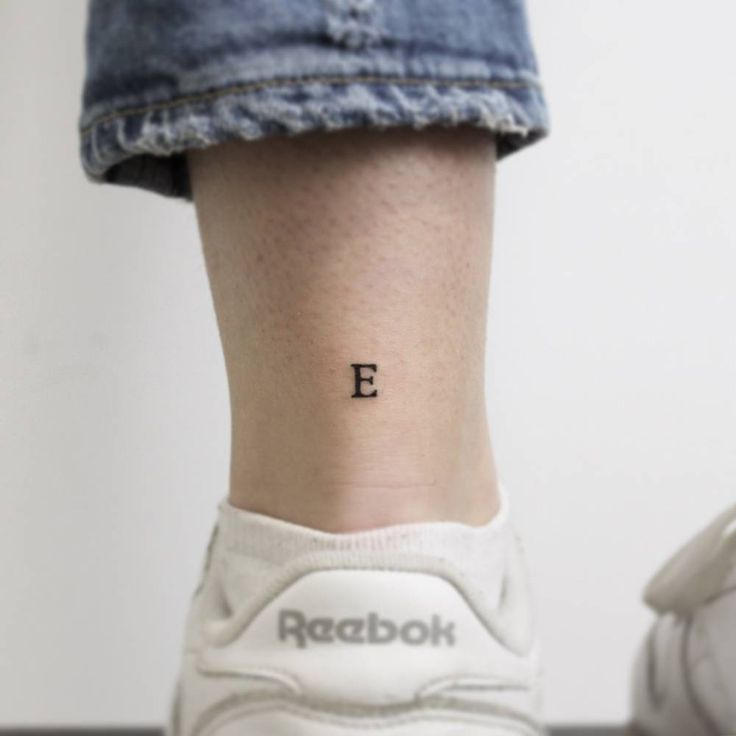 """Small stamped e-tattoo on the … # Tattoo Placement Tiny letter """"E"""" tattoo on the back of the left ankle"""