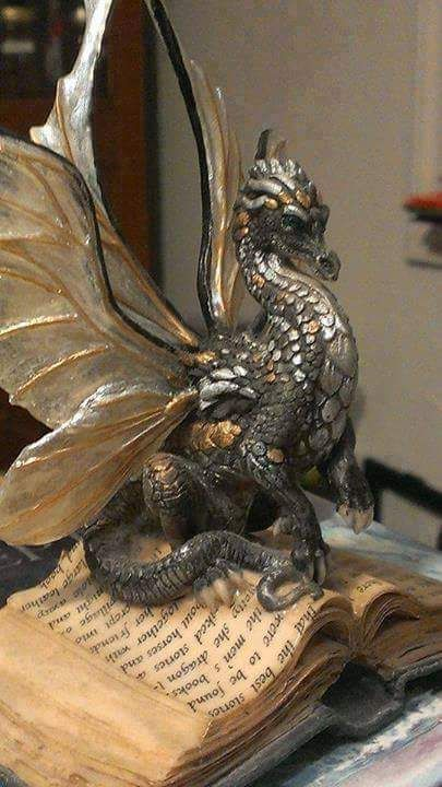 "moonroseridesabesom: "" Pewter and gold dragon, artist unknown - Andrew Clinton """