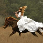 Ok, props to the girl who can ride her horse bareback, bridle-less, in a wedding dress, while playing a violin.  Wow.
